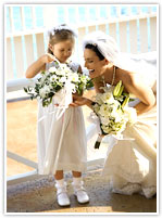 Beautiful bride with flowergirl